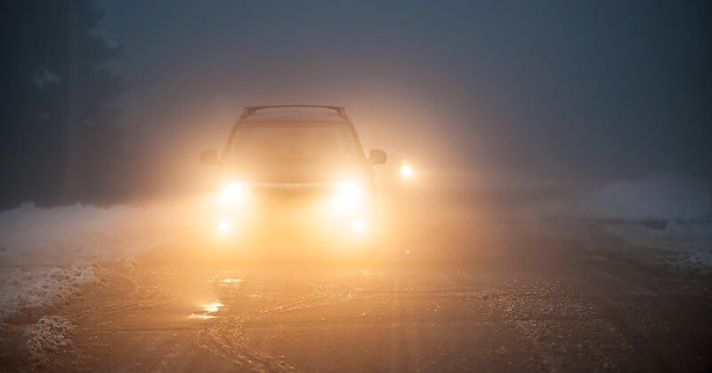 driving on cold and foggy road