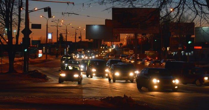 Car headlights on at night