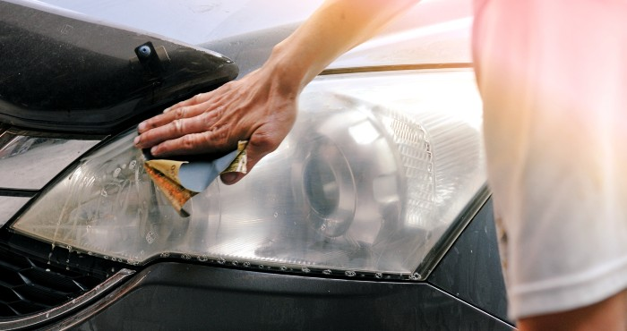 Cleaning headlights with sandpaper
