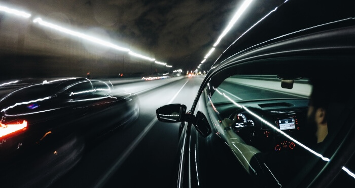 Cars with headlights on the road