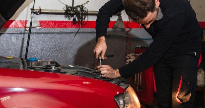 man fixing car headlight